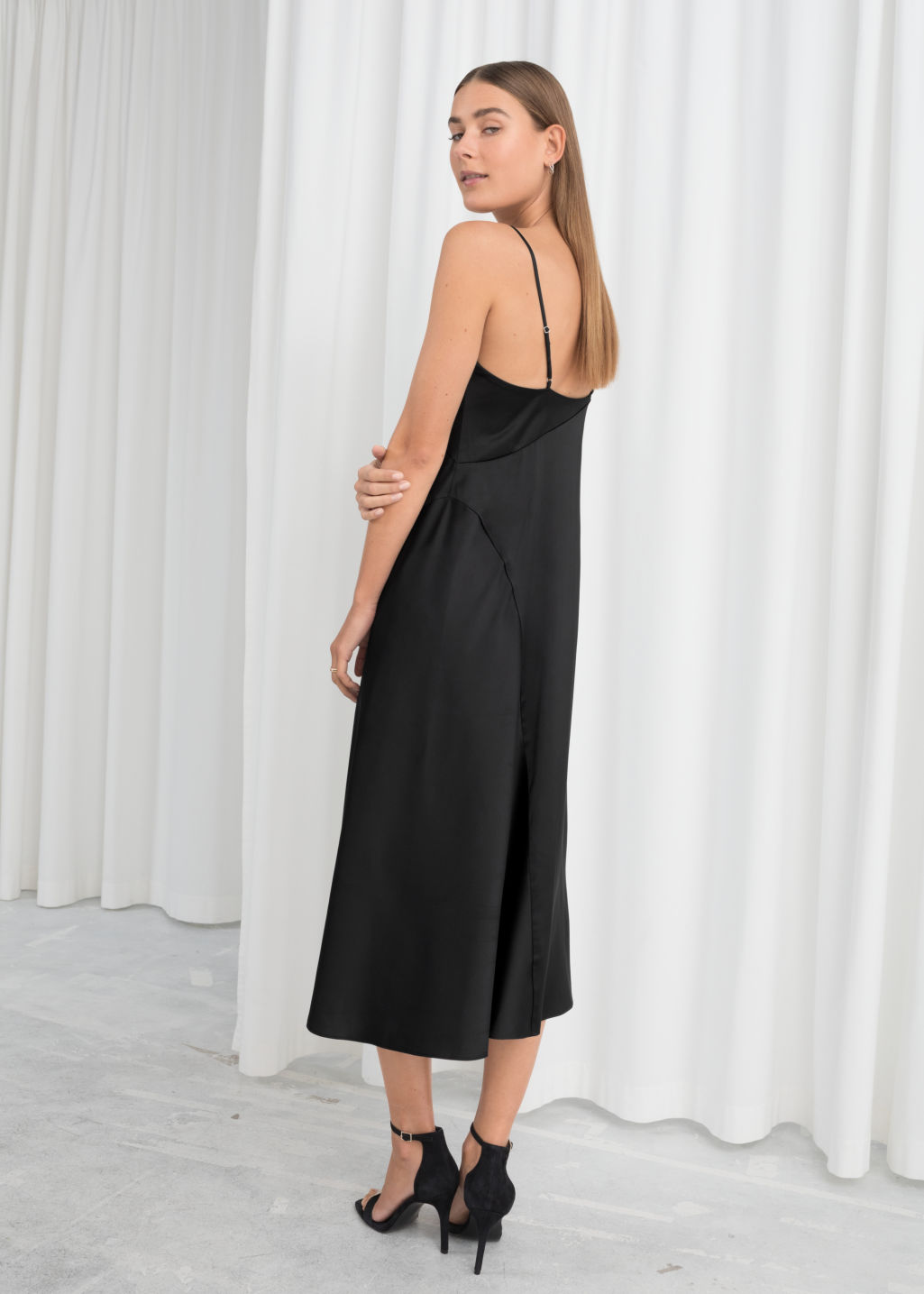 Model back image of Stories midi slip dress in black