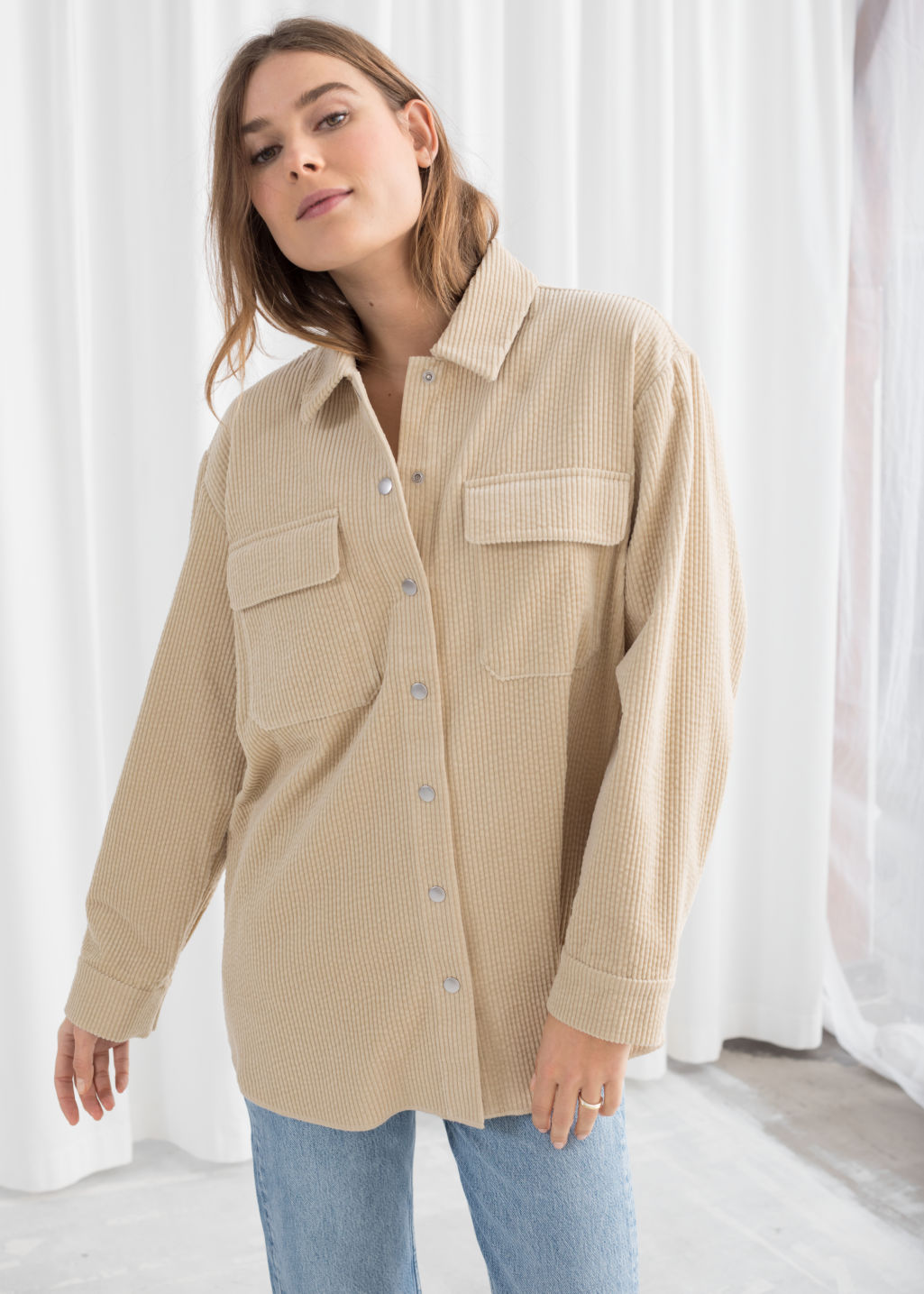 Model front image of Stories oversize corduroy workwear shirt in beige