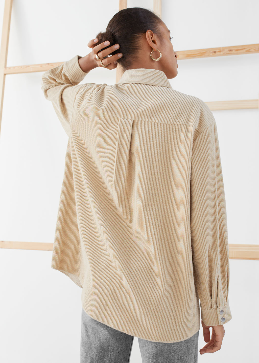 Model back image of Stories oversized corduroy workwear shirt in beige