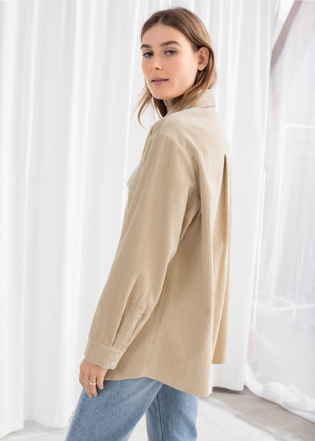Model back image of Stories oversize corduroy workwear shirt in beige