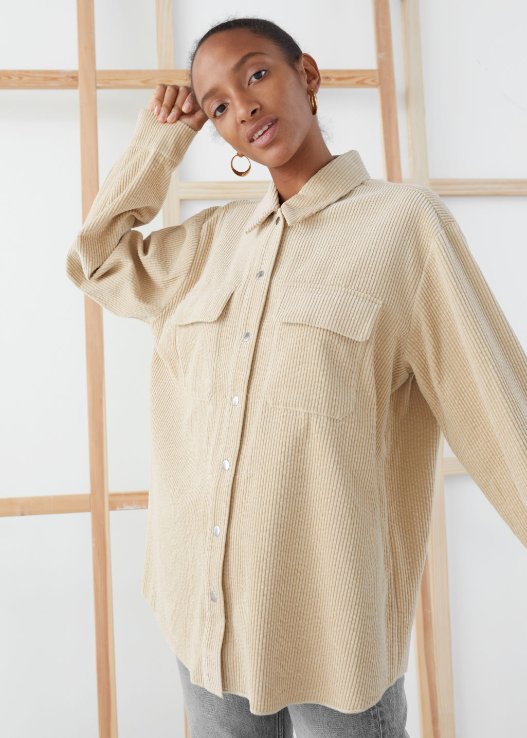 Model front image of Stories oversized corduroy workwear shirt in beige