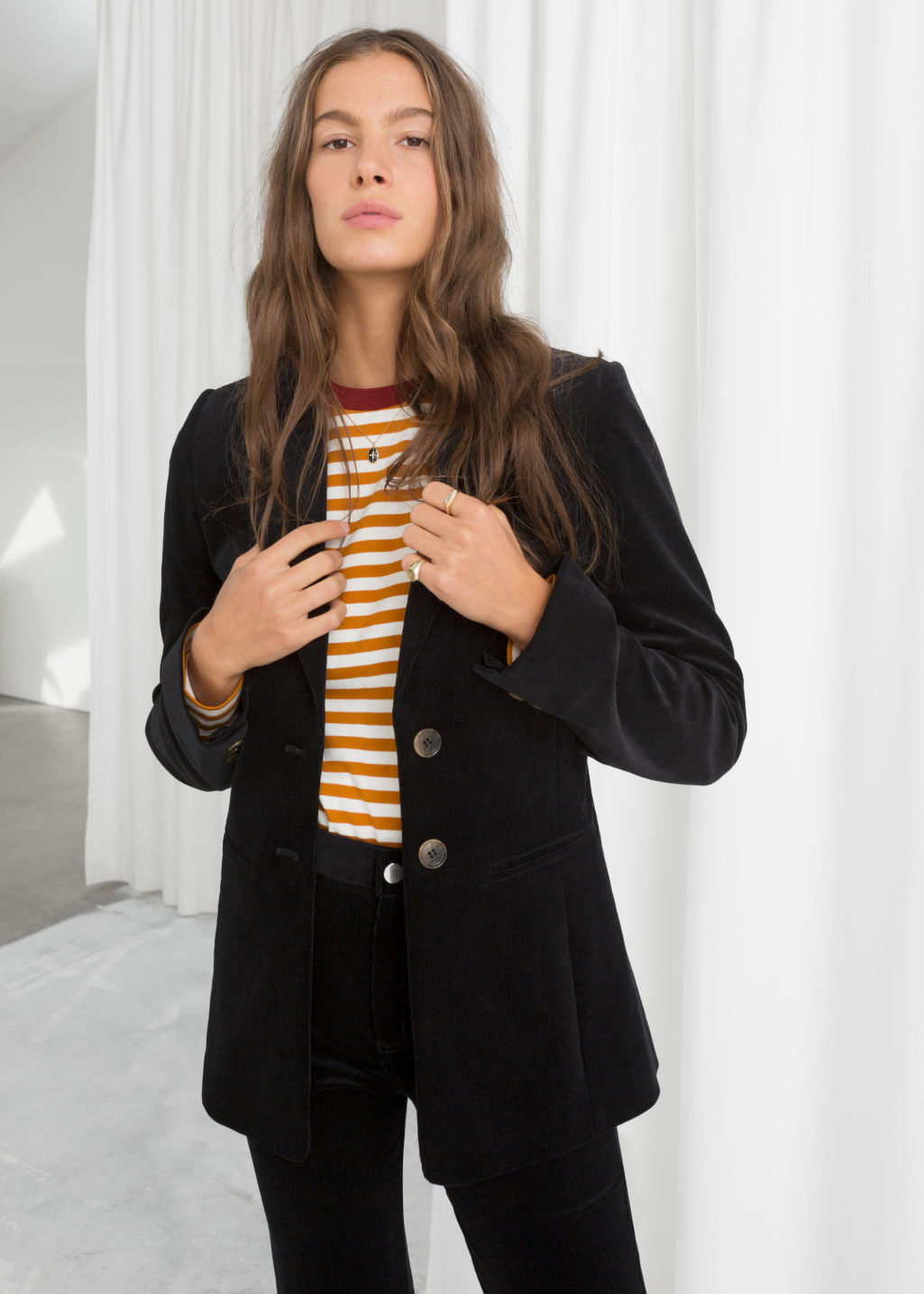 Model front image of Stories corduroy blazer in black