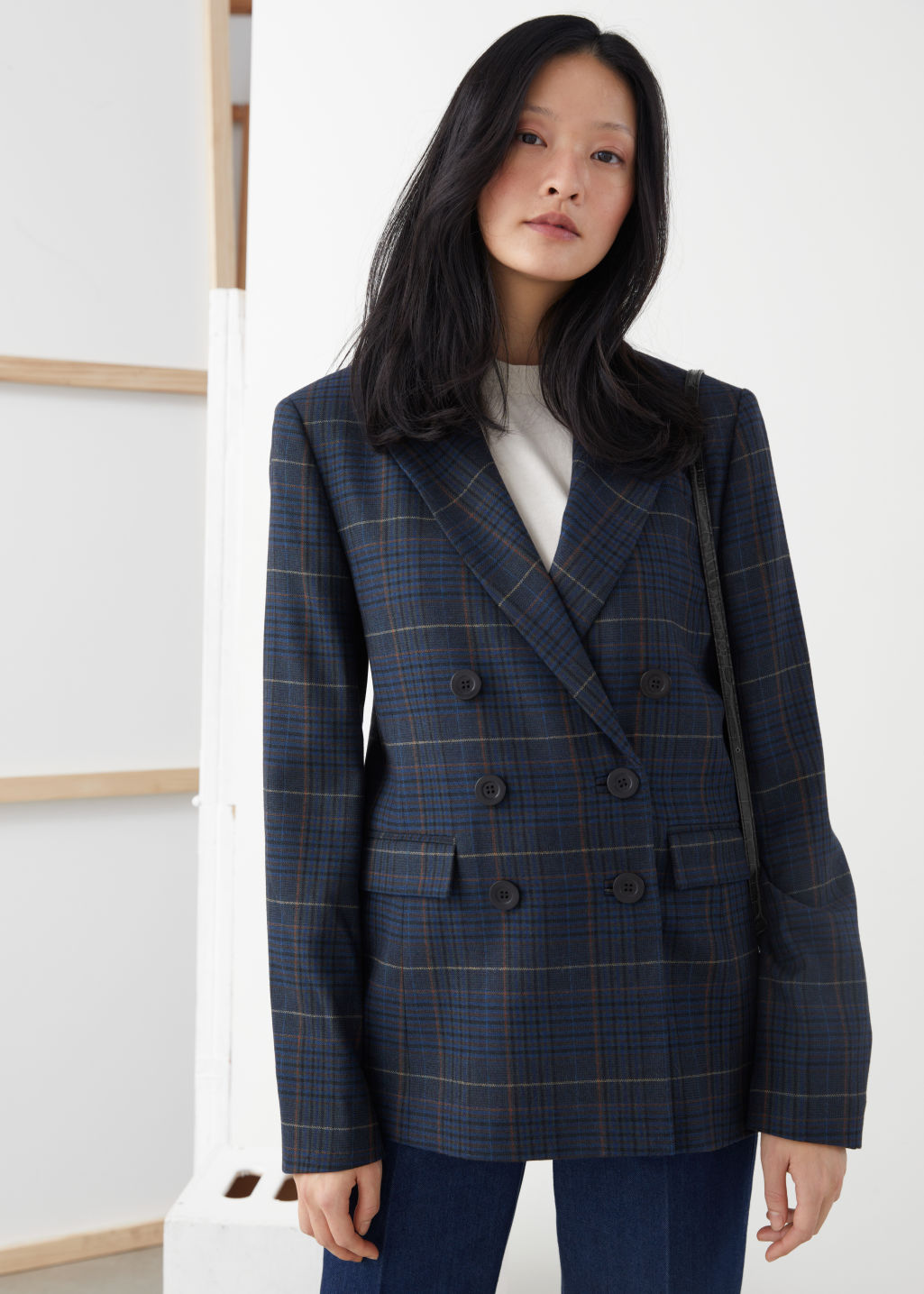 Model front image of Stories wool blend plaid blazer in blue