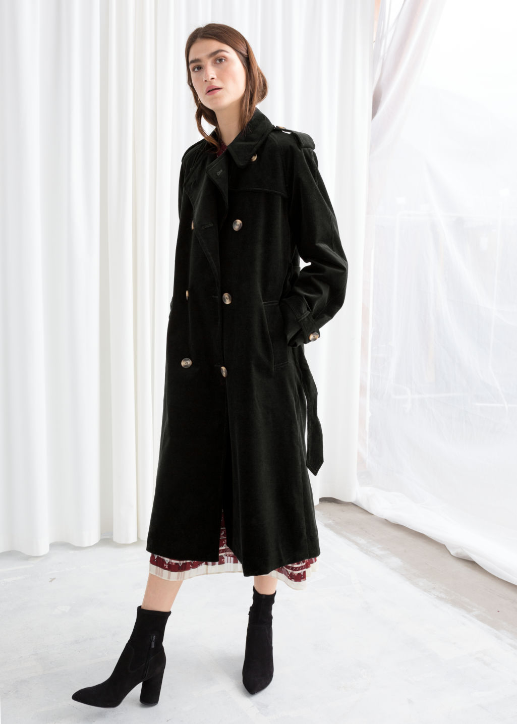 Model front image of Stories belted cotton cord trenchcoat in black