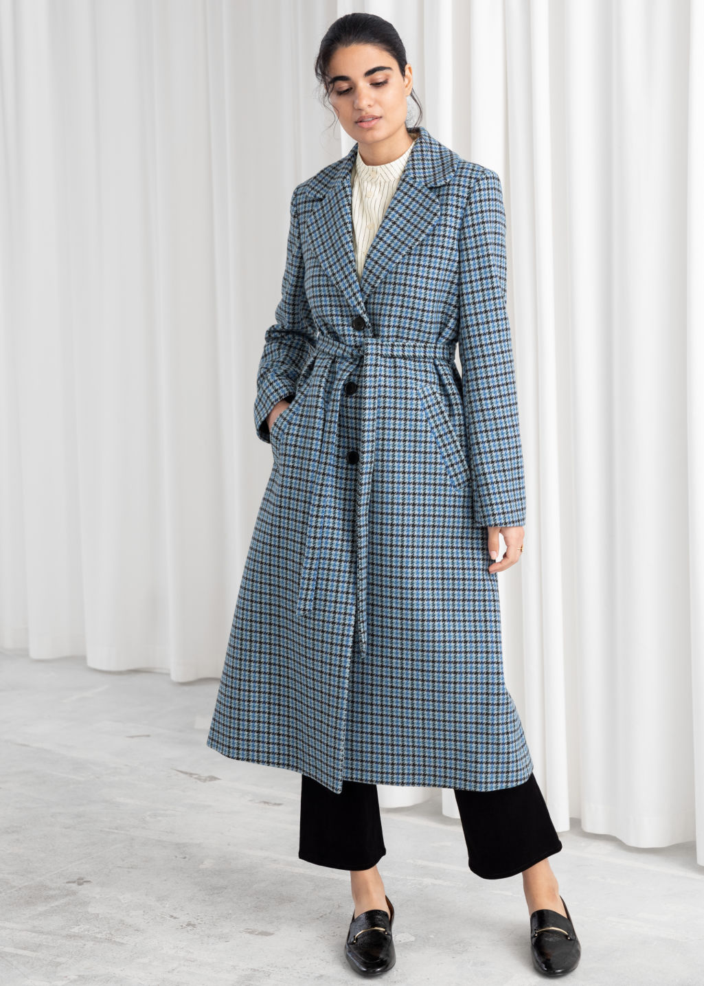 Model front image of Stories a-line wool blend belted coat in blue