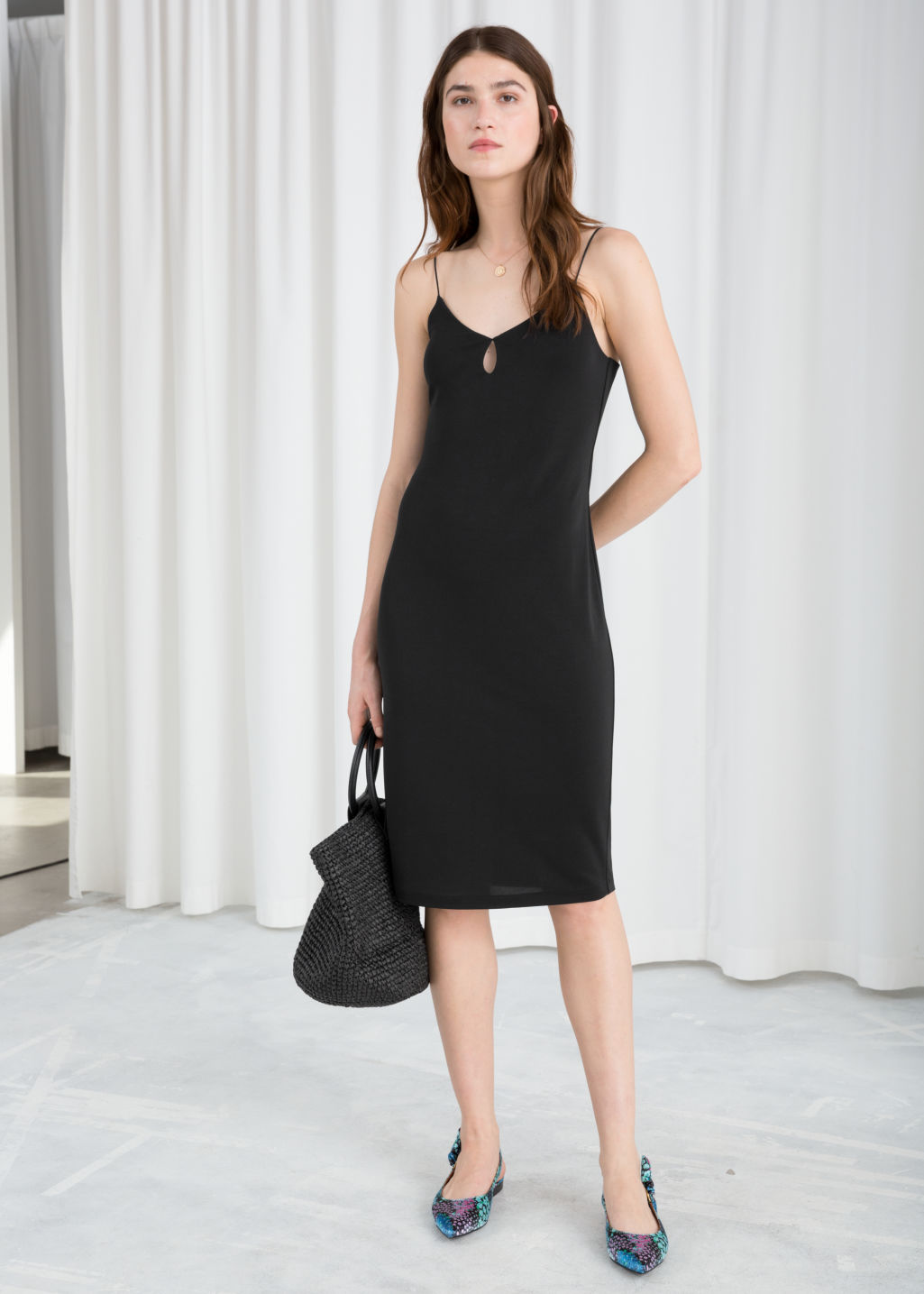 Model front image of Stories fitted keyhole midi dress in black