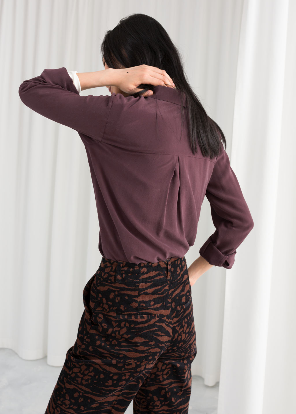 Model back image of Stories silk button down shirt in purple