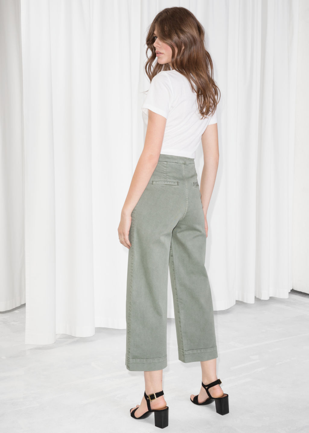 Model back image of Stories faded denim culottes  in green