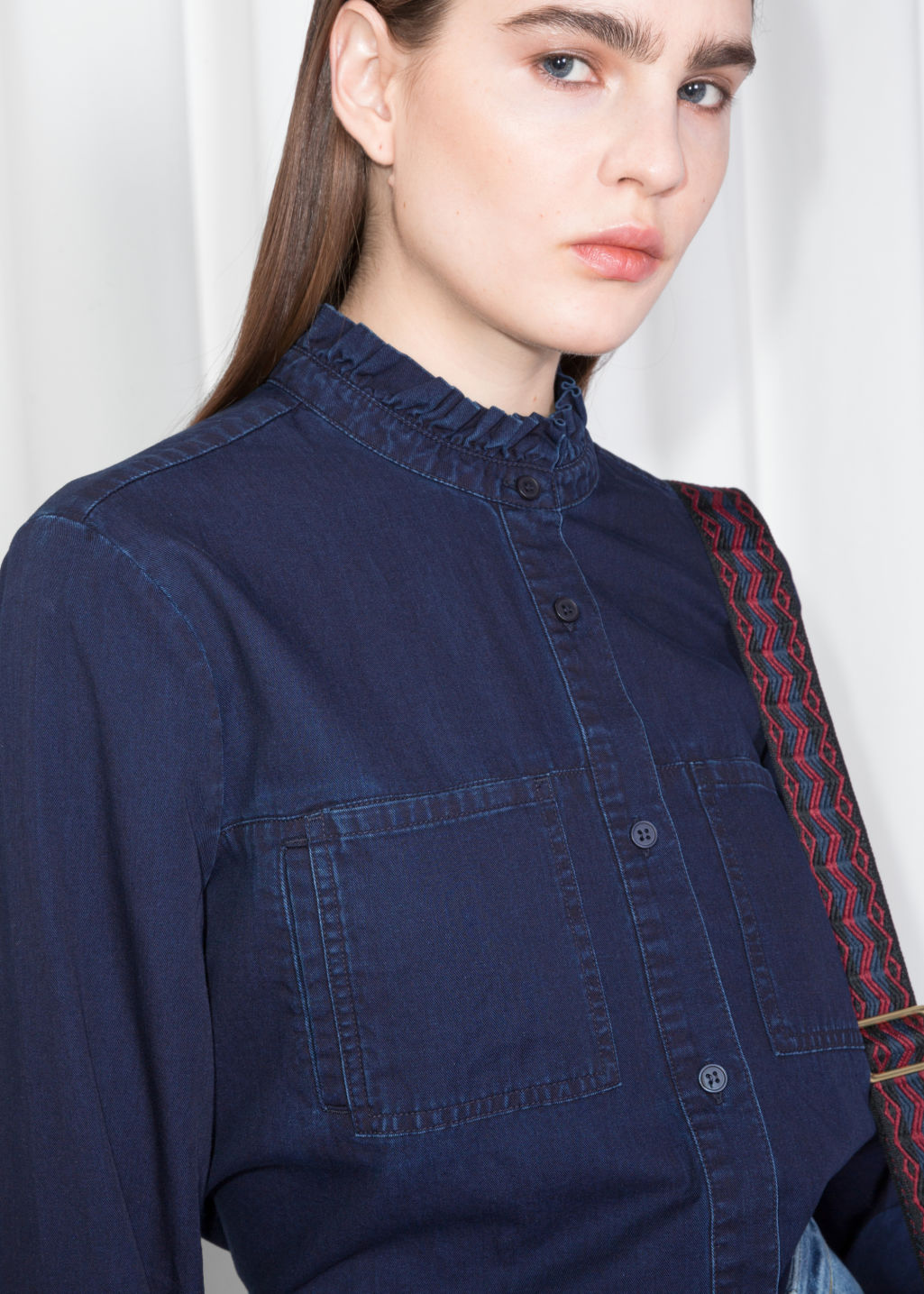 Model back image of Stories denim utilitarian shirt in blue