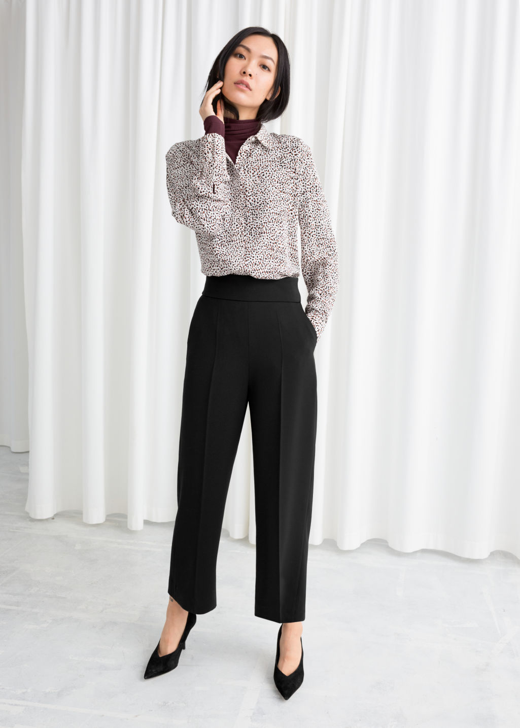 Model front image of Stories cropped high waisted trousers in black
