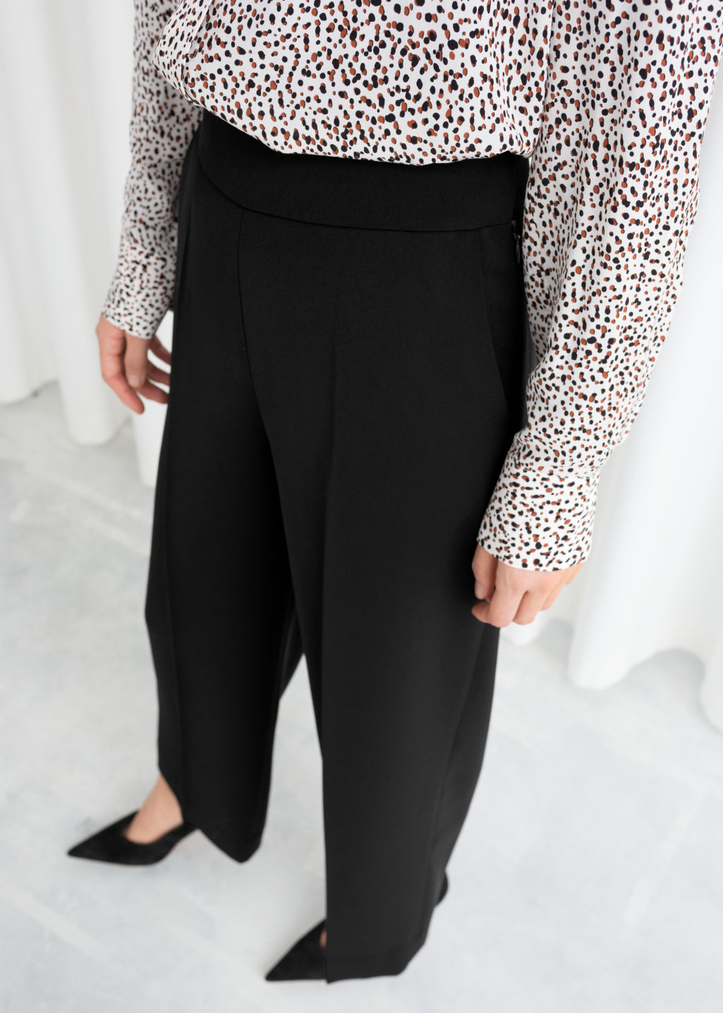 Model back image of Stories cropped high waisted trousers in black