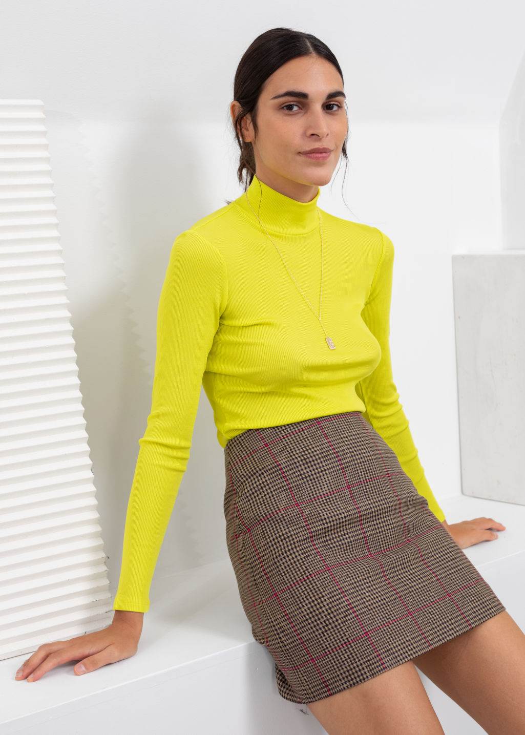 Model front image of Stories houndstooth mini skirt in beige