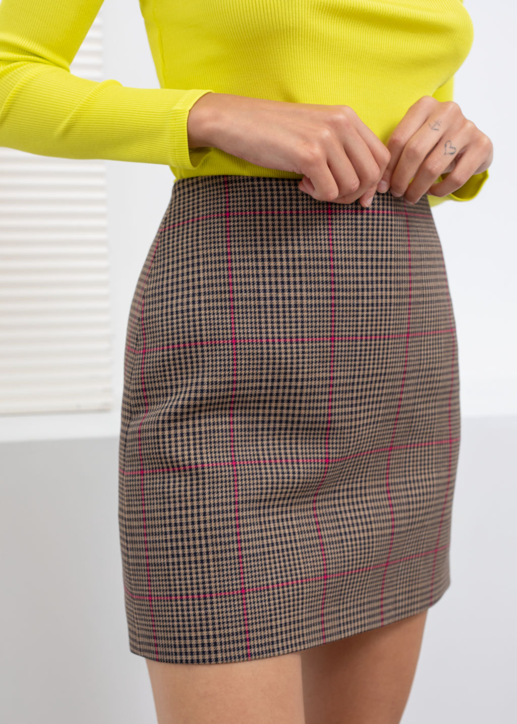 Model back image of Stories houndstooth mini skirt in beige