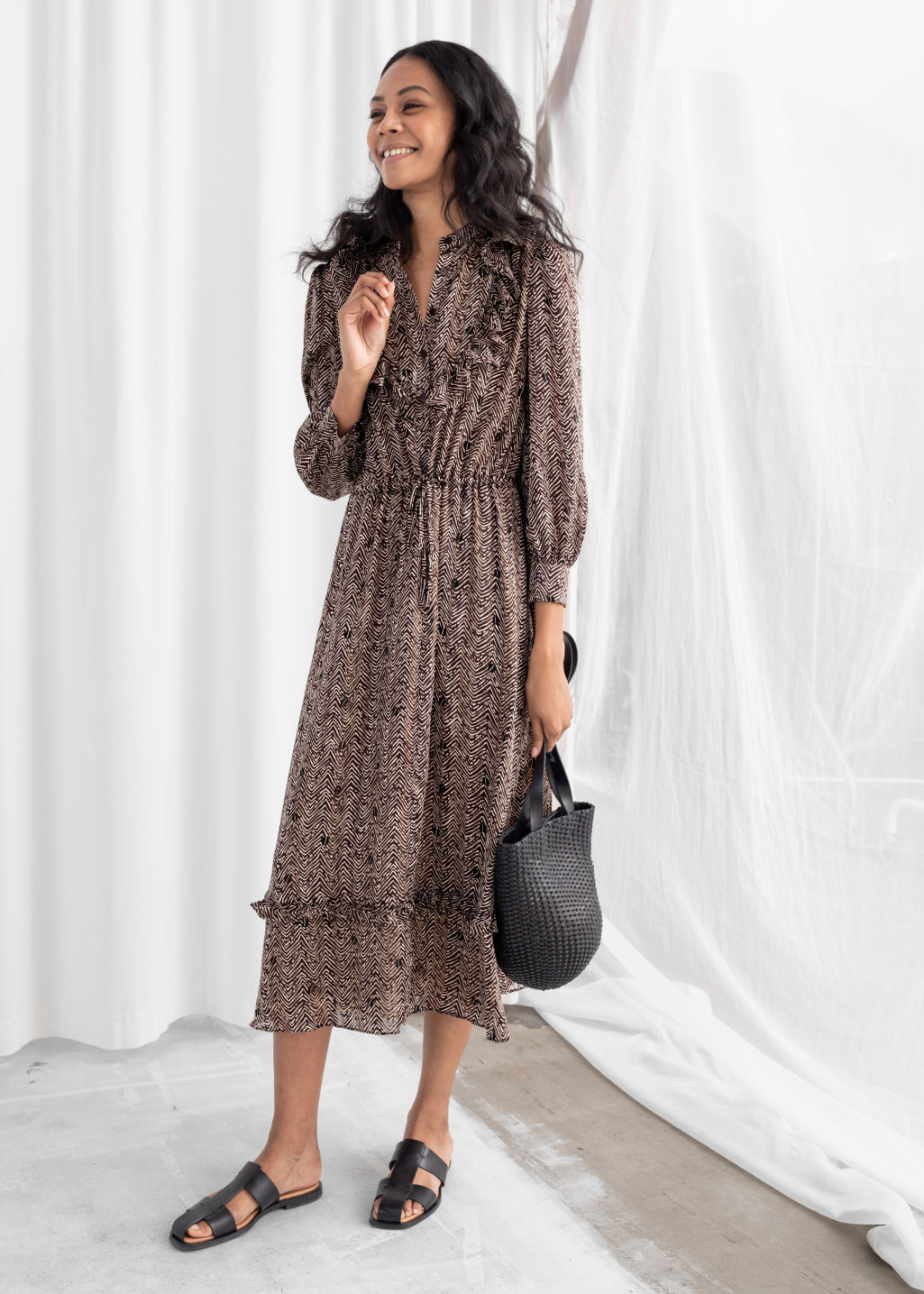 Model front image of Stories printed ruffle bib midi dress in brown