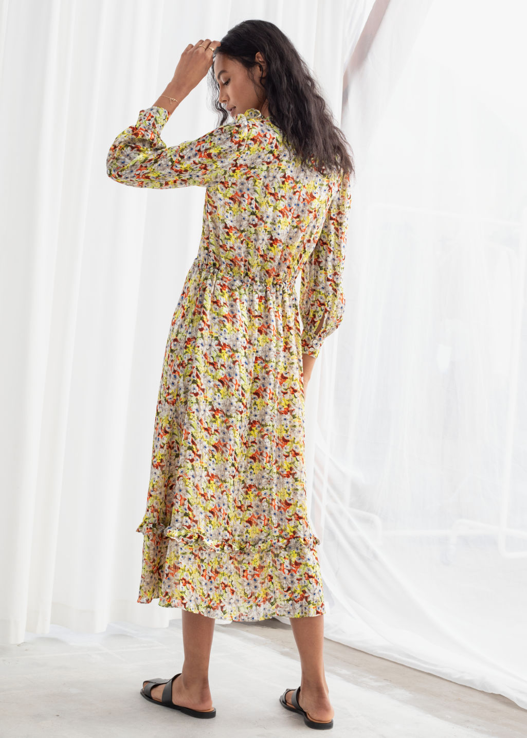 Model back image of Stories printed ruffle bib midi dress in yellow
