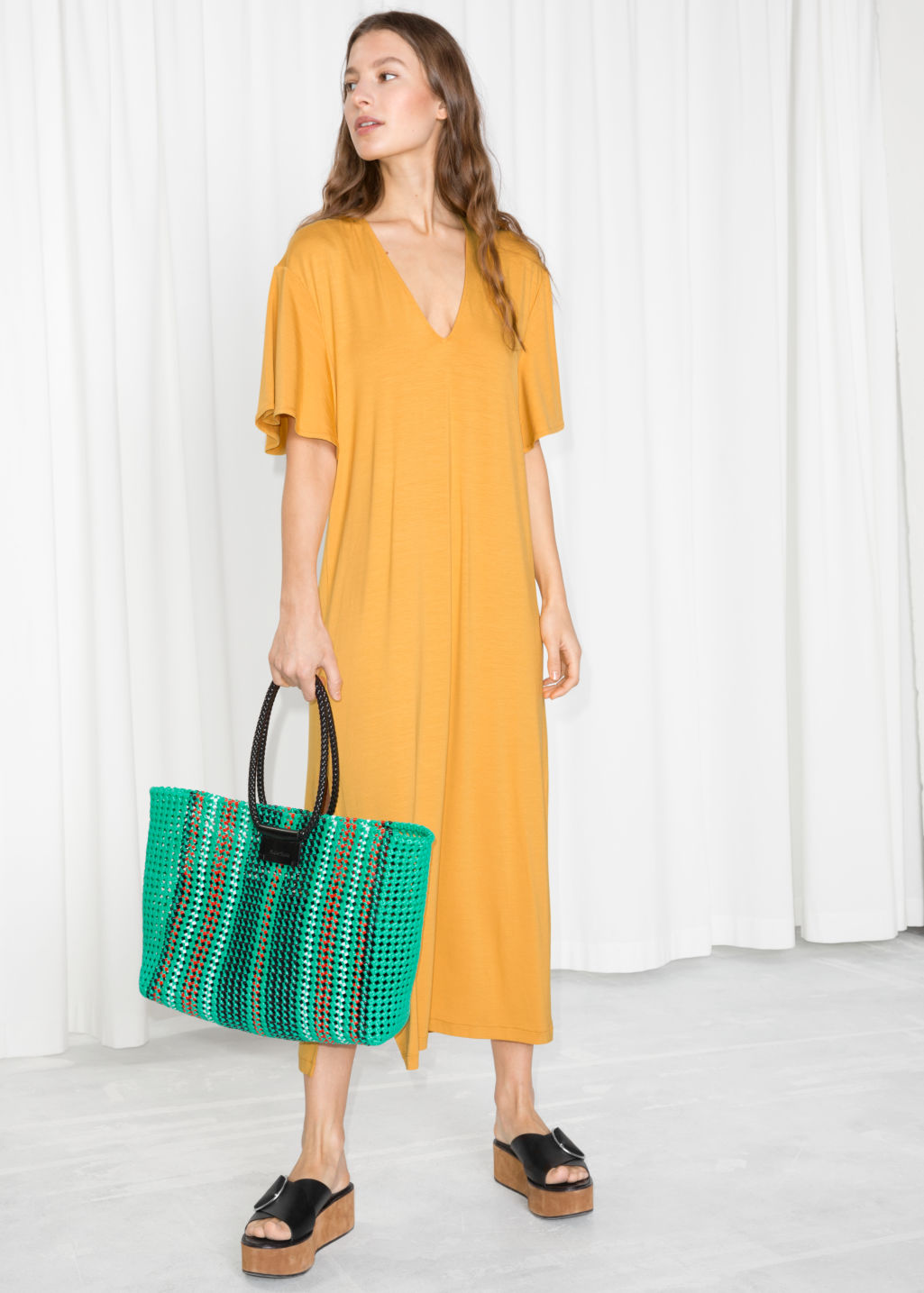 Model front image of Stories v neck midi shirt dress in yellow
