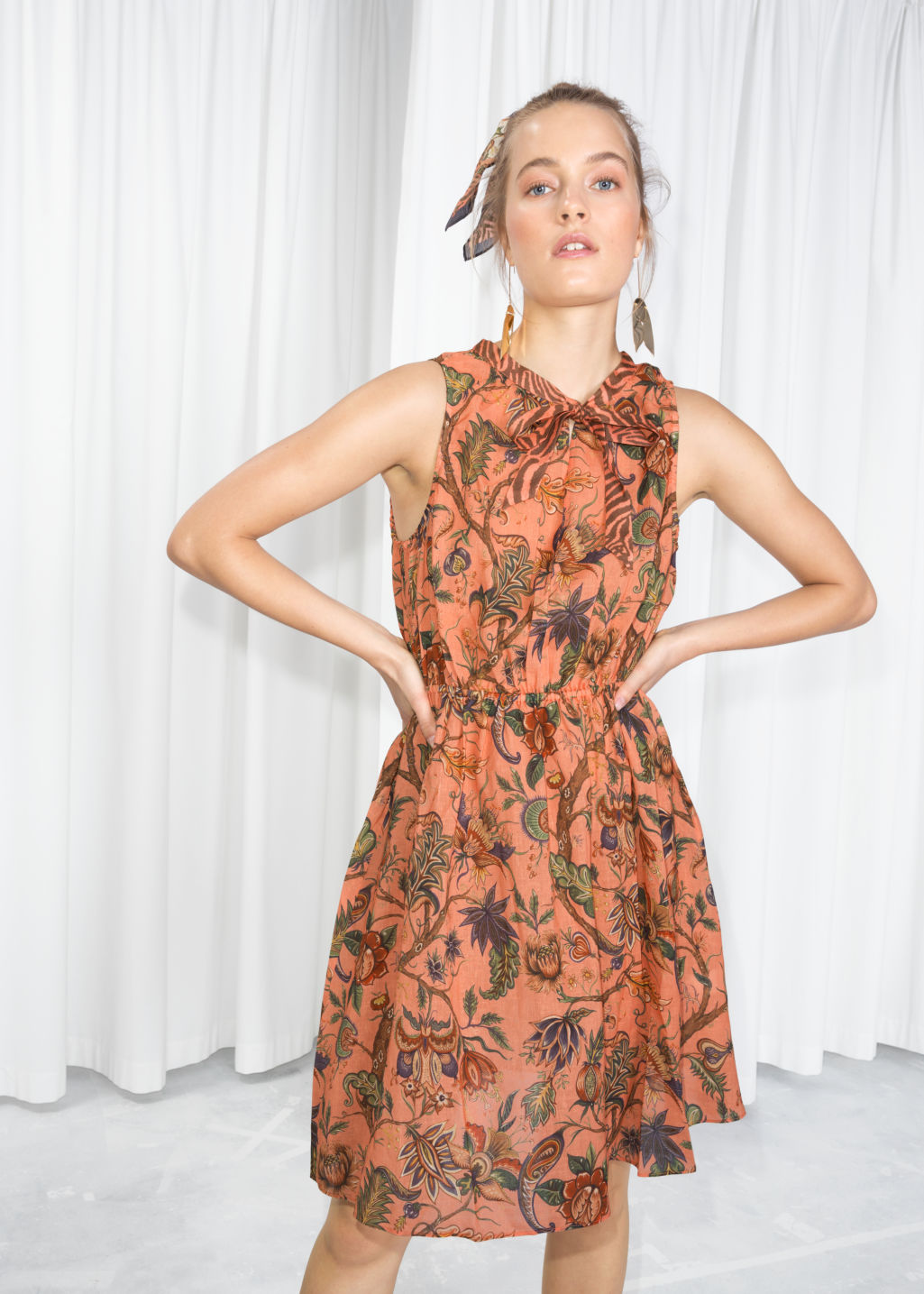Model front image of Stories house of hackney dress in orange