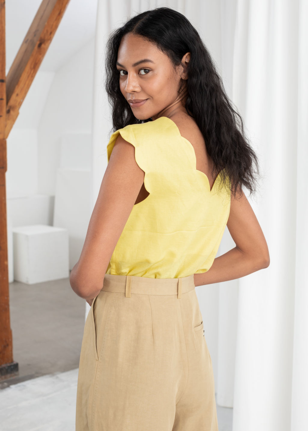 Model back image of Stories linen blend scalloped tank top in yellow