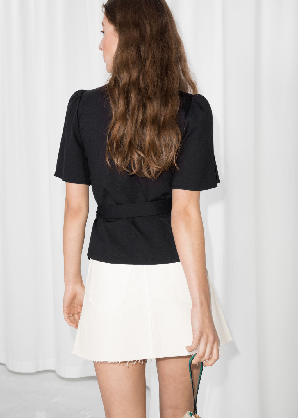 Model back image of Stories d-ring belted wrap top  in black