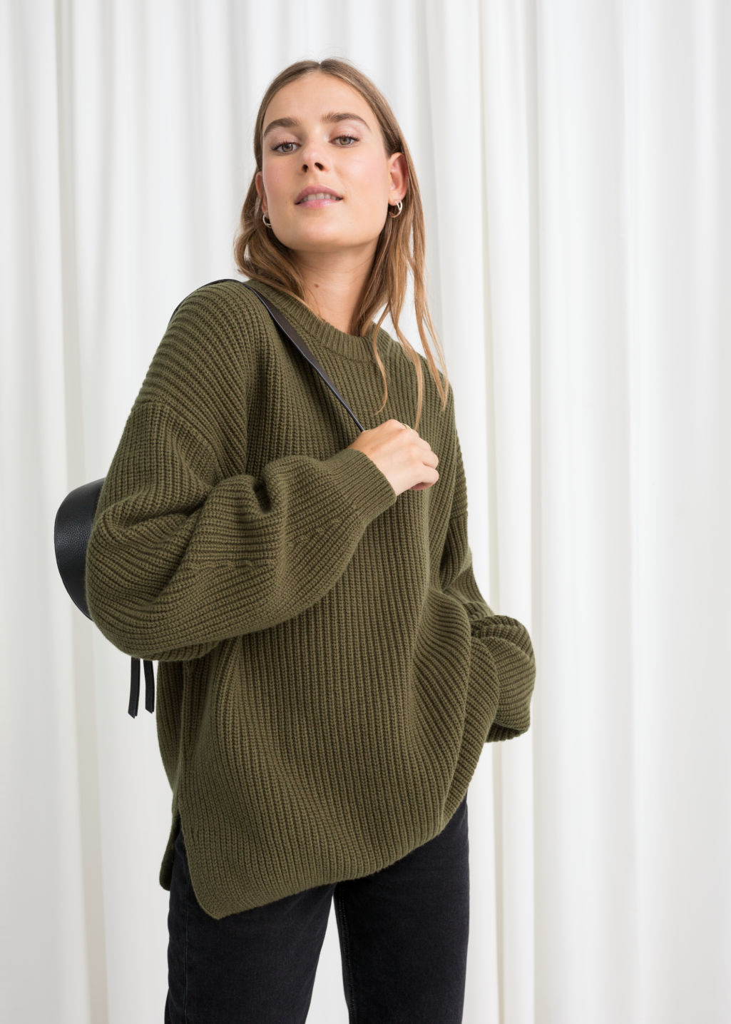 Model front image of Stories oversized wool blend sweater in green