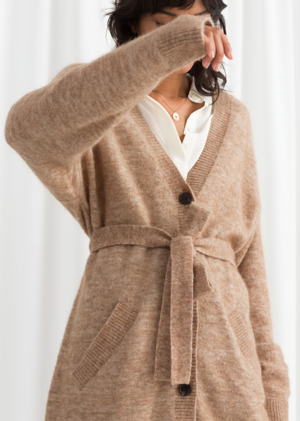 Model back image of Stories striped belted cardigan  in beige