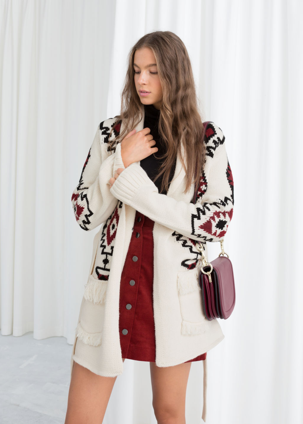 Model front image of Stories southwestern knit belted cardigan in white