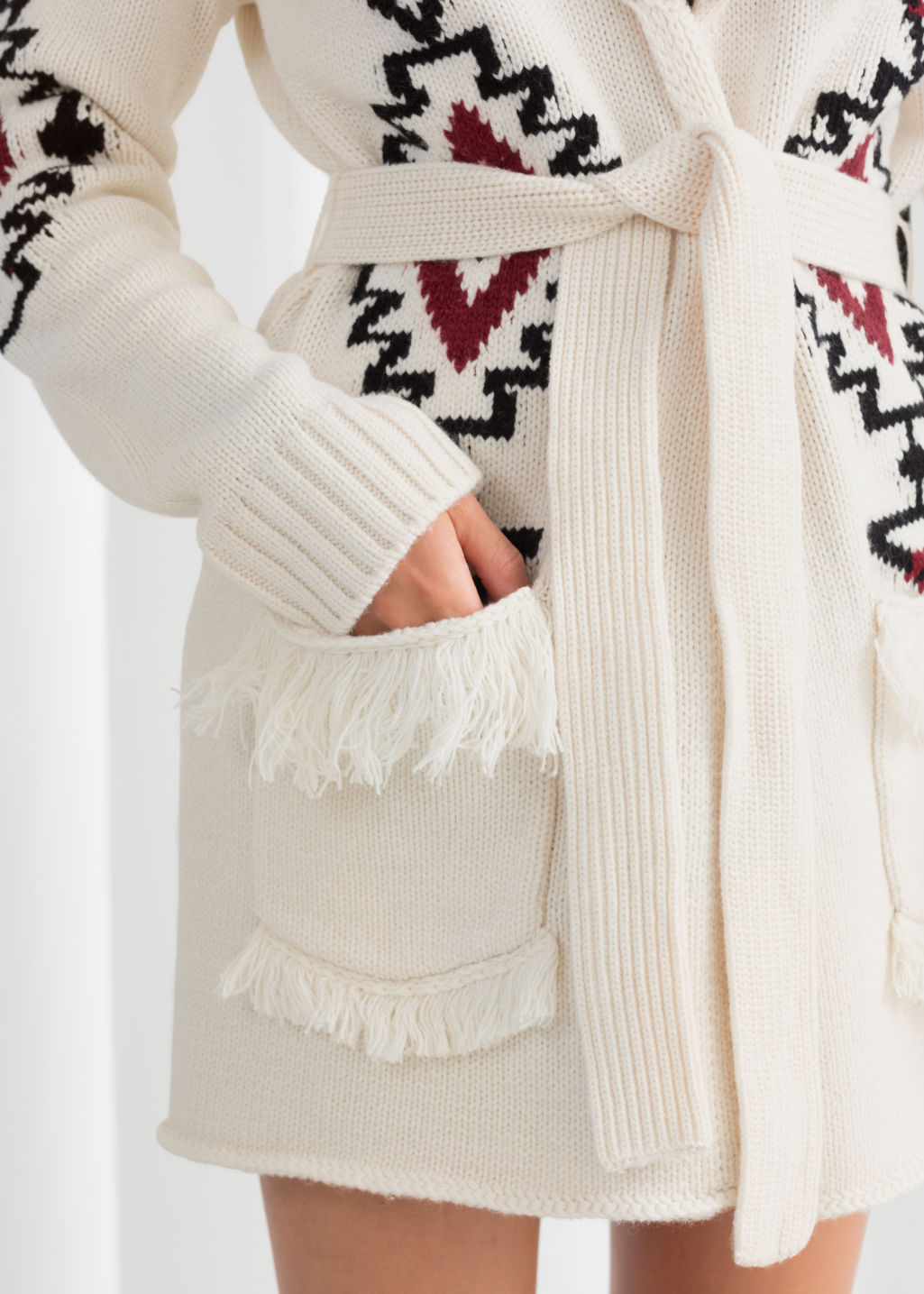 Model back image of Stories southwestern knit belted cardigan in white