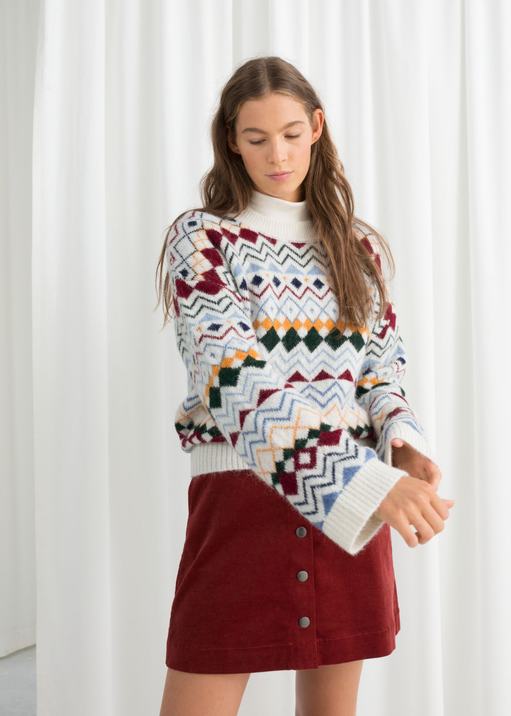 Model front image of Stories fairisle knit sweater in white