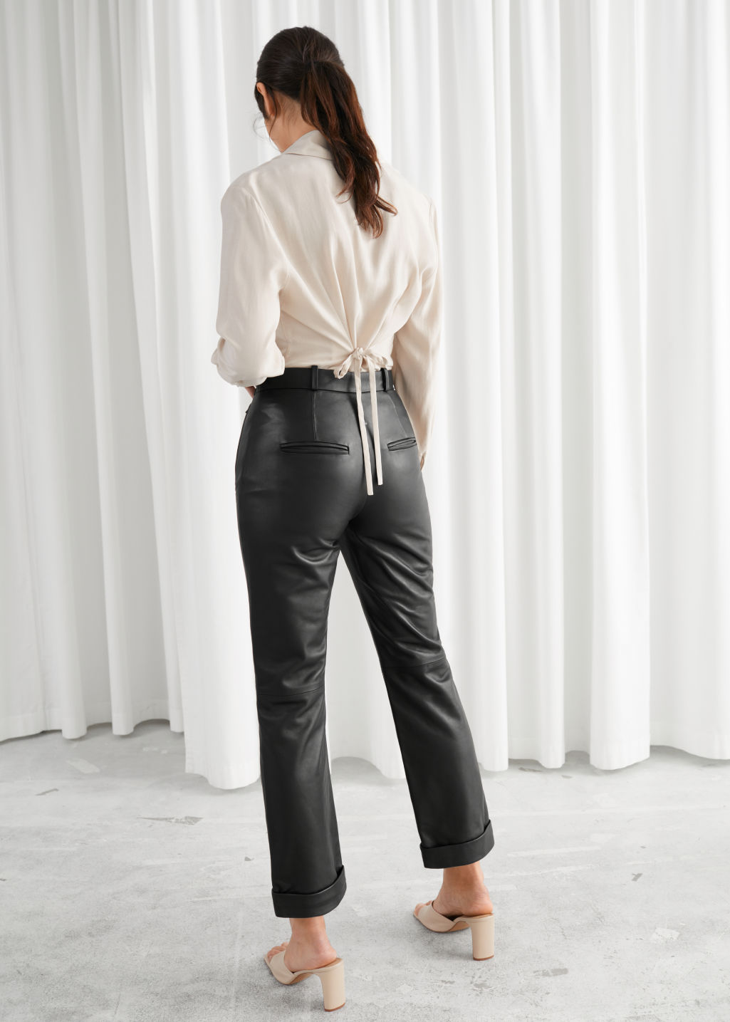 Model back image of Stories cuffed leather trousers in black