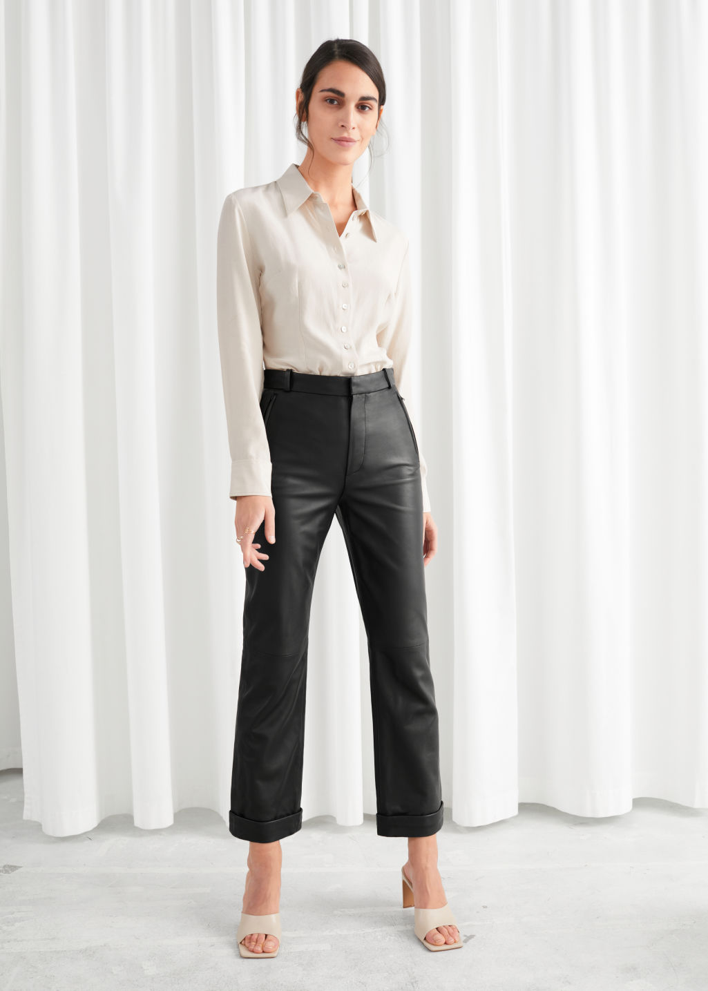 Model front image of Stories cuffed leather trousers in black