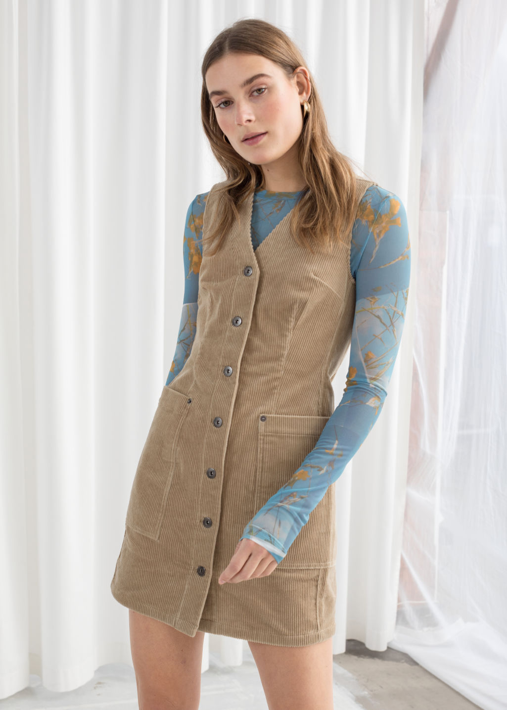 Model front image of Stories corduroy workwear mini dress in beige