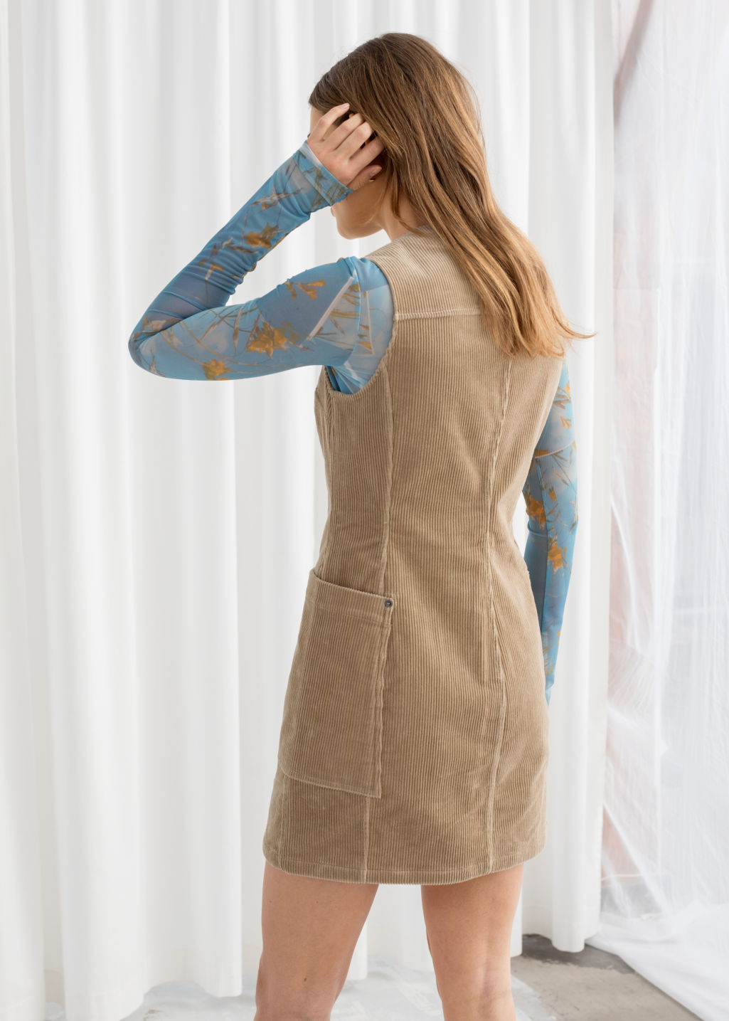 Model back image of Stories corduroy workwear mini dress in beige