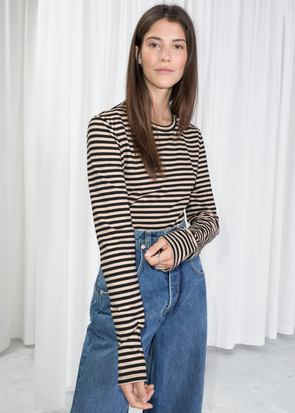 Model front image of Stories losse fit stripe shirt in black