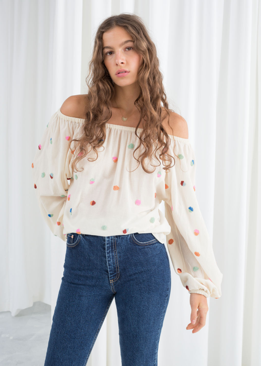 Model front image of Stories billowy embroidered bardot blouse in white
