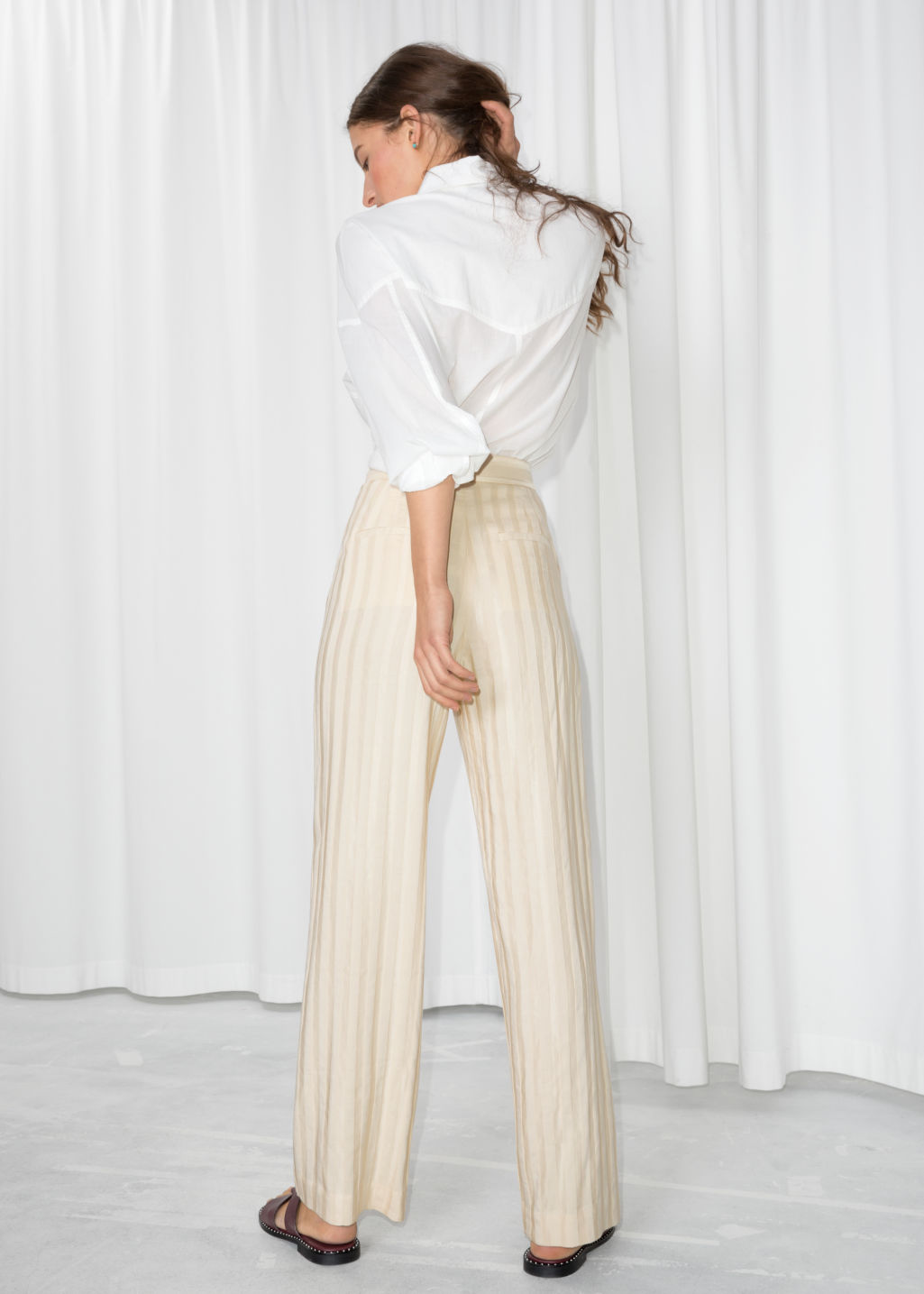 Model back image of Stories linen blend stripe trousers in beige