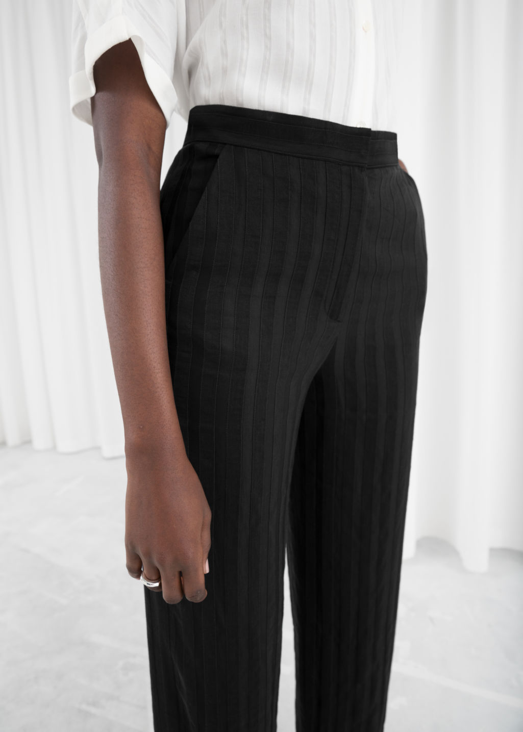 Model back image of Stories linen blend stripe trousers in black