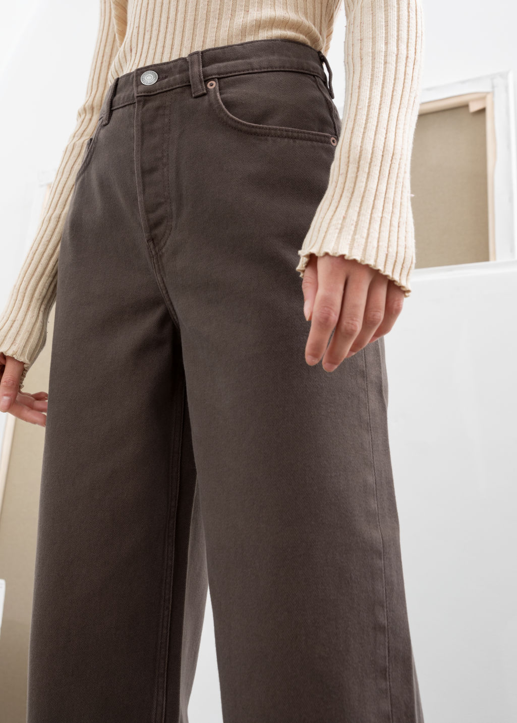 Model back image of Stories loose mid rise jeans in brown