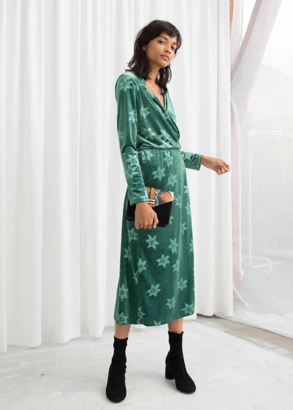 Model front image of Stories floral velour wrap dress in green