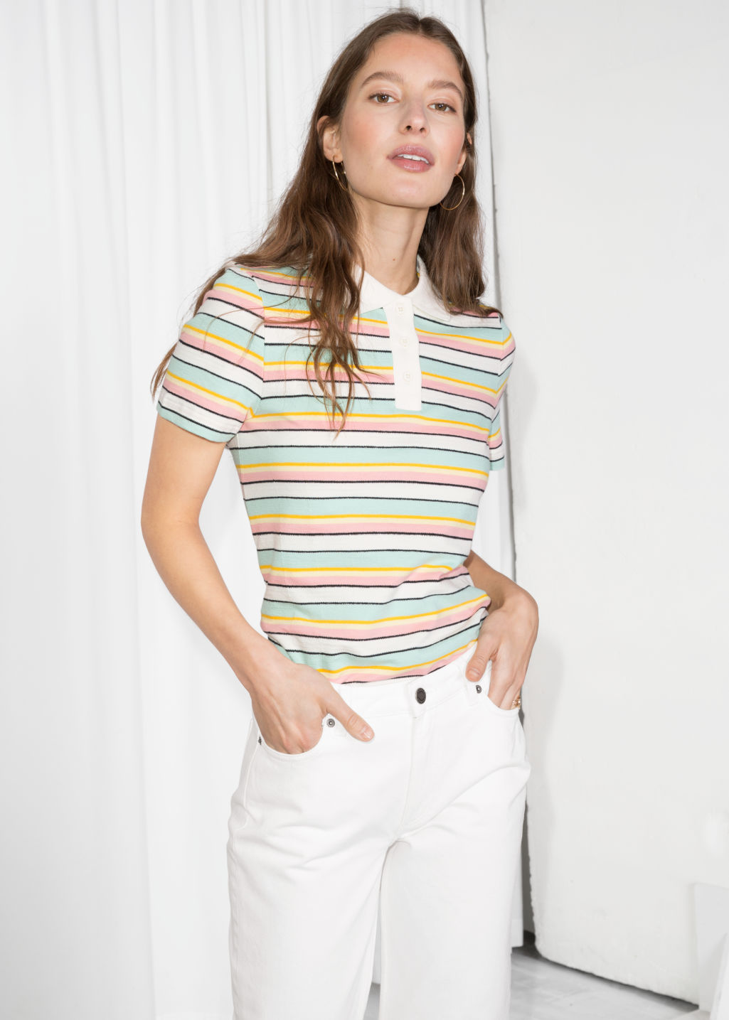 Model front image of Stories striped polo t-shirt in white
