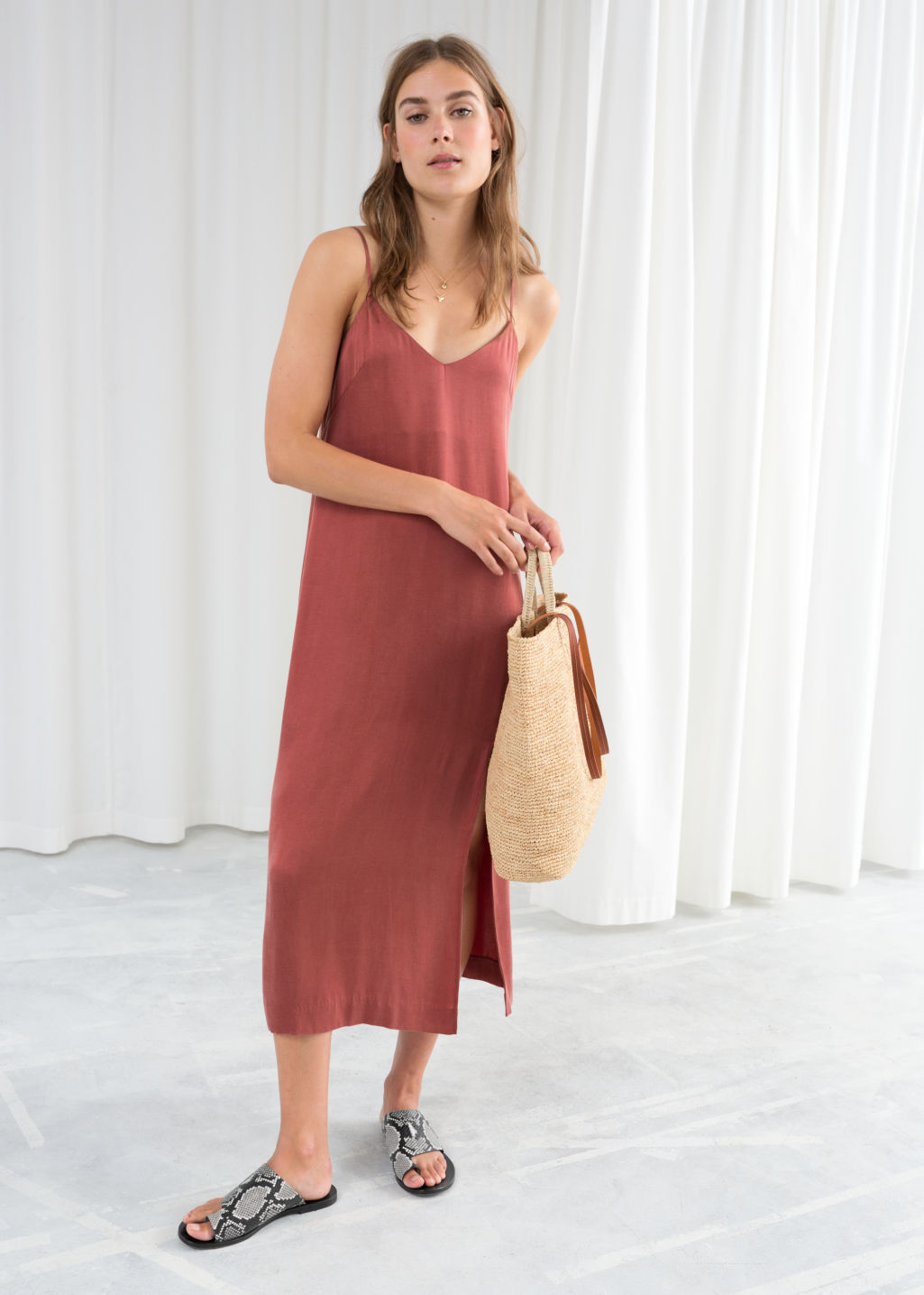 Model front image of Stories midi slip dress in orange