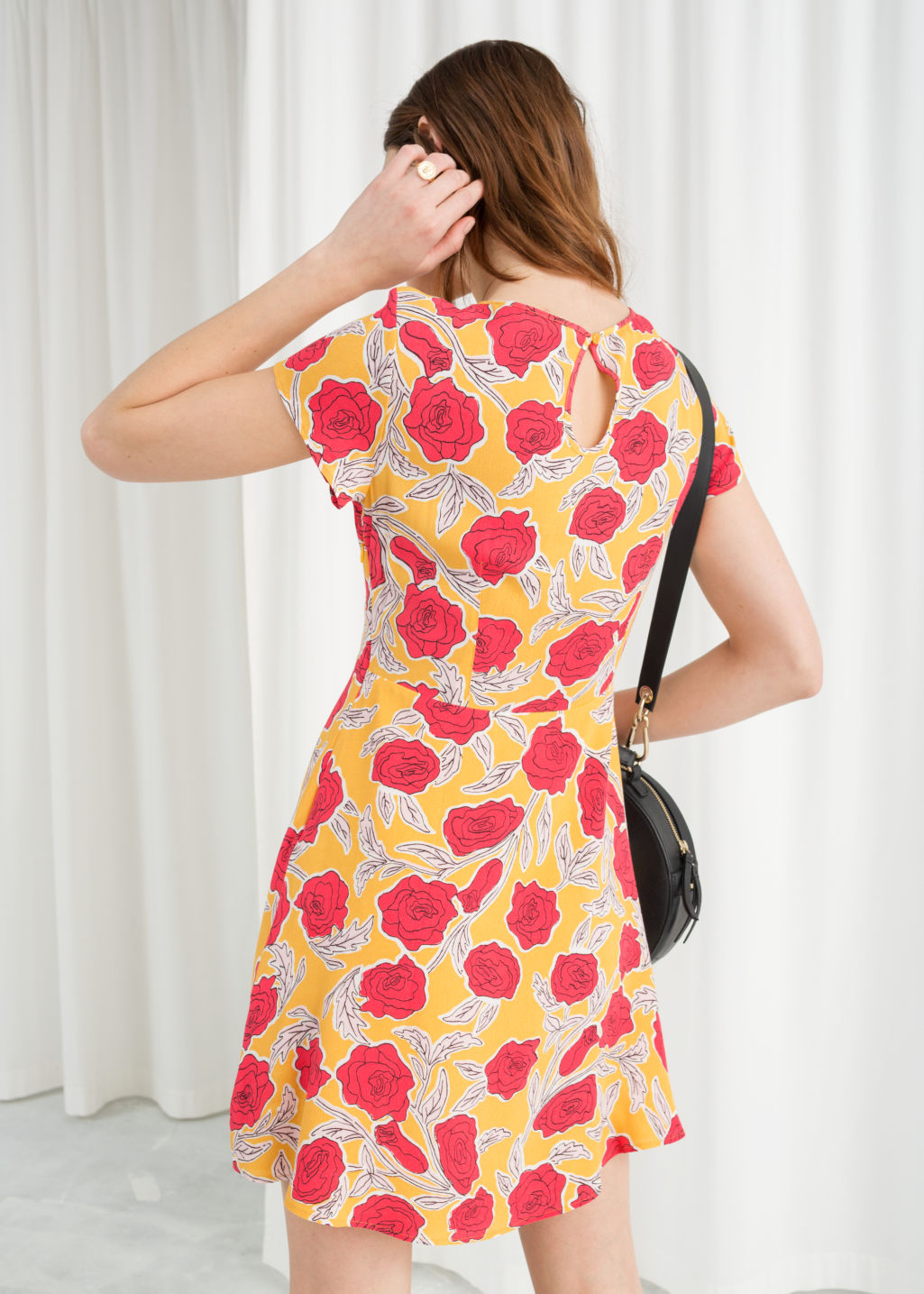 Model back image of Stories floral printed skater dress in yellow