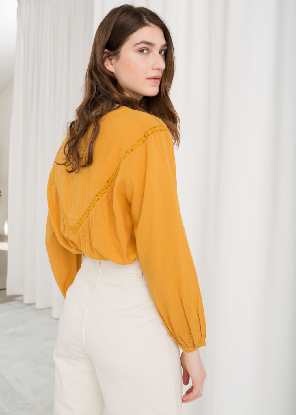 Model back image of Stories cotton peasant blouse in yellow