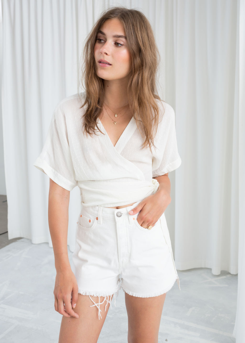 Model front image of Stories belted wrap blouse in white