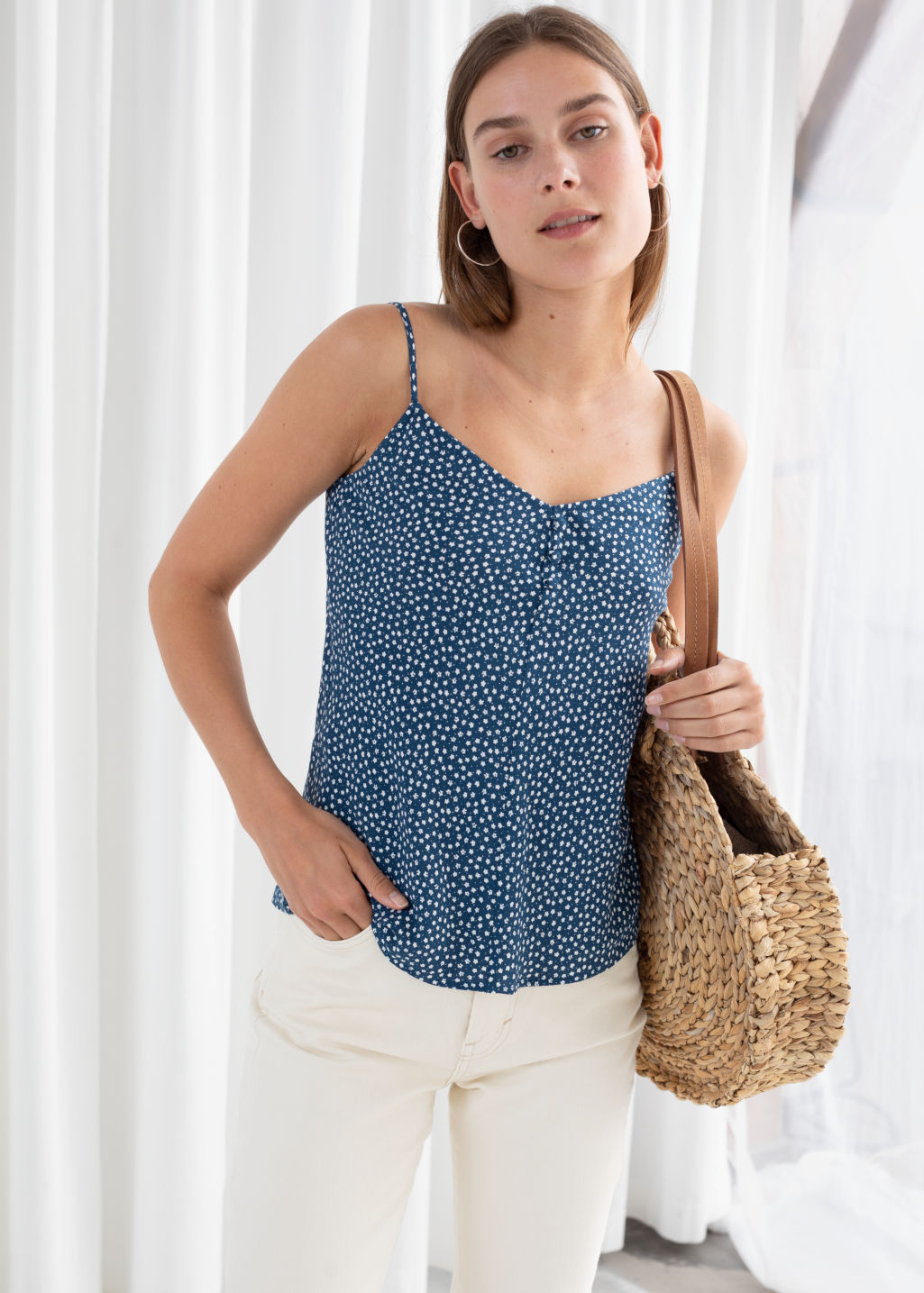 Model front image of Stories micro floral tank top in blue