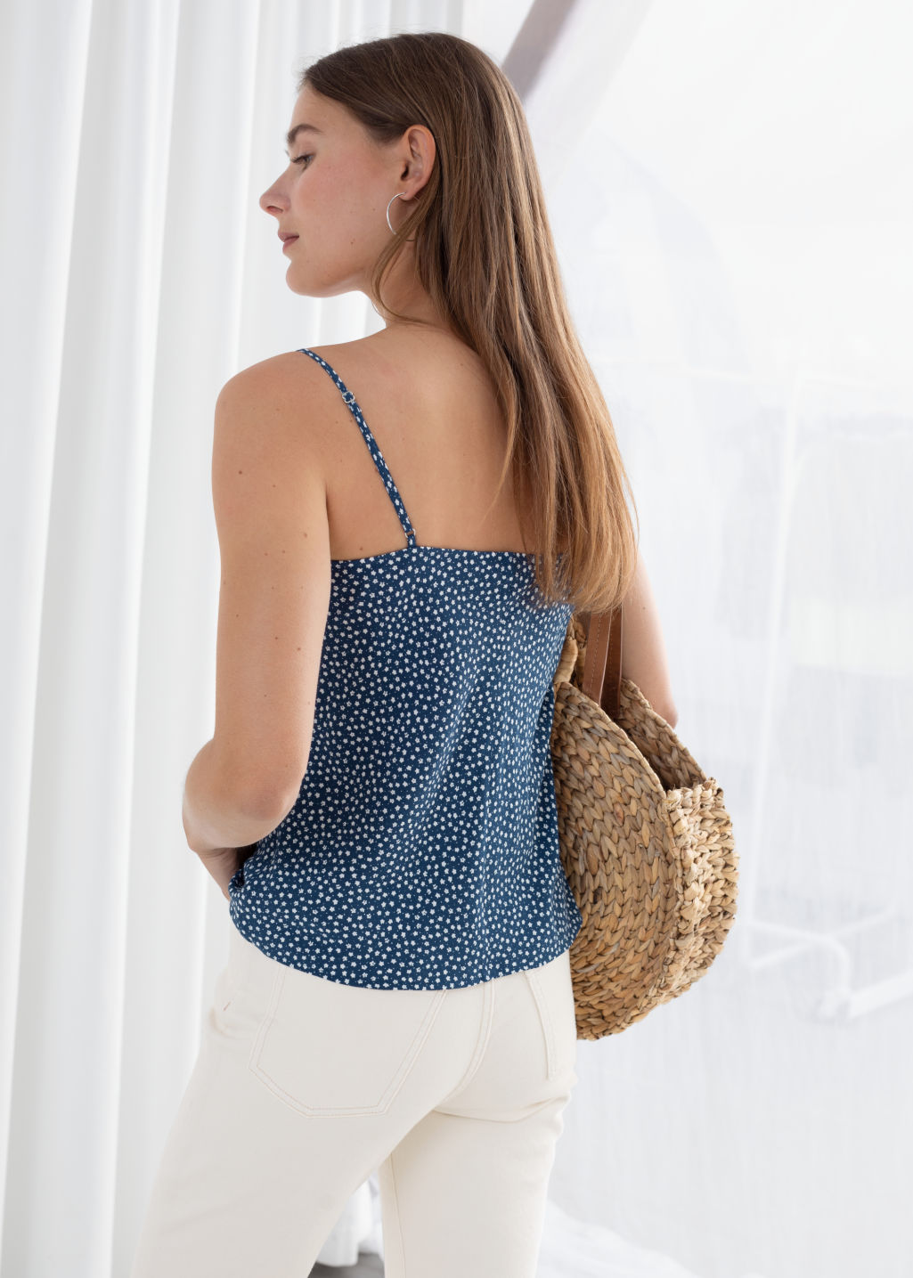 Model back image of Stories micro floral tank top in blue