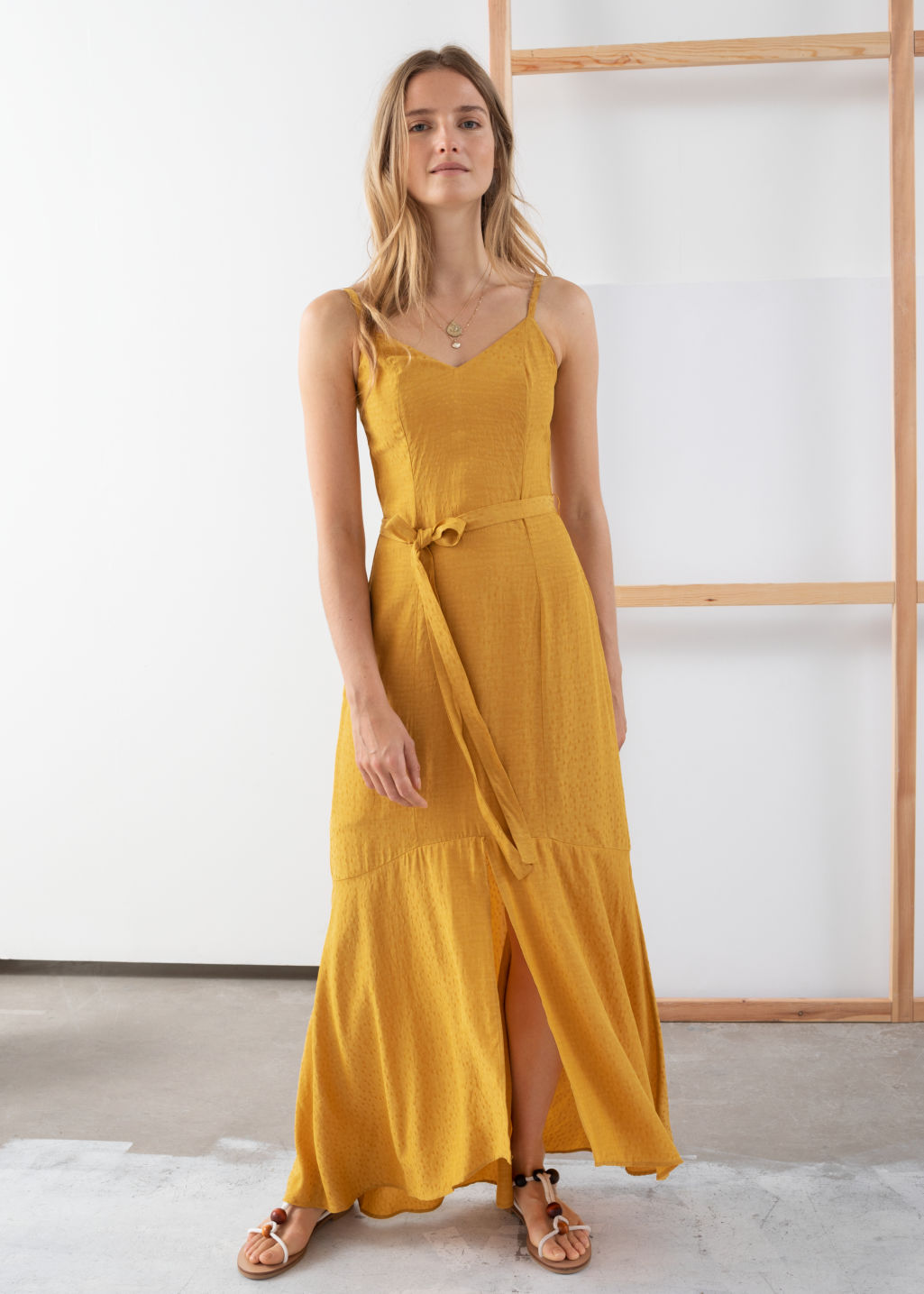 Model front image of Stories belted midi dress in yellow