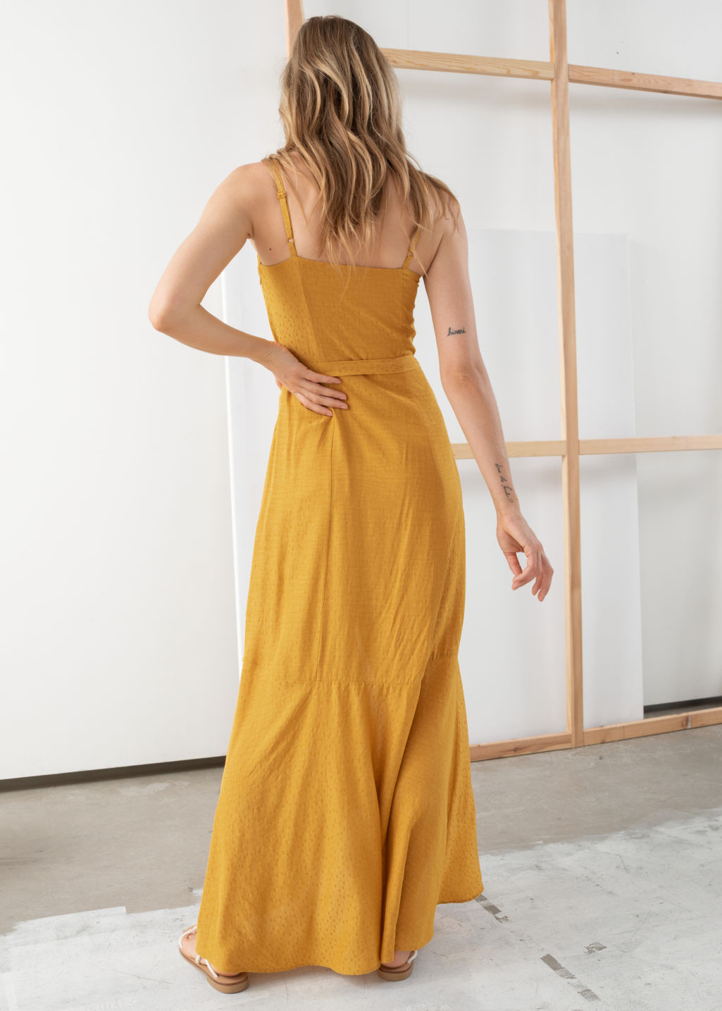 Model back image of Stories belted midi dress in yellow