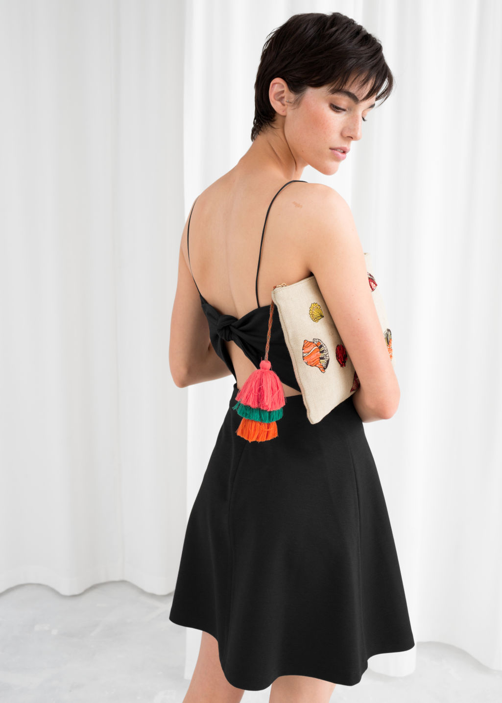 Model back image of Stories tie back mini dress in black