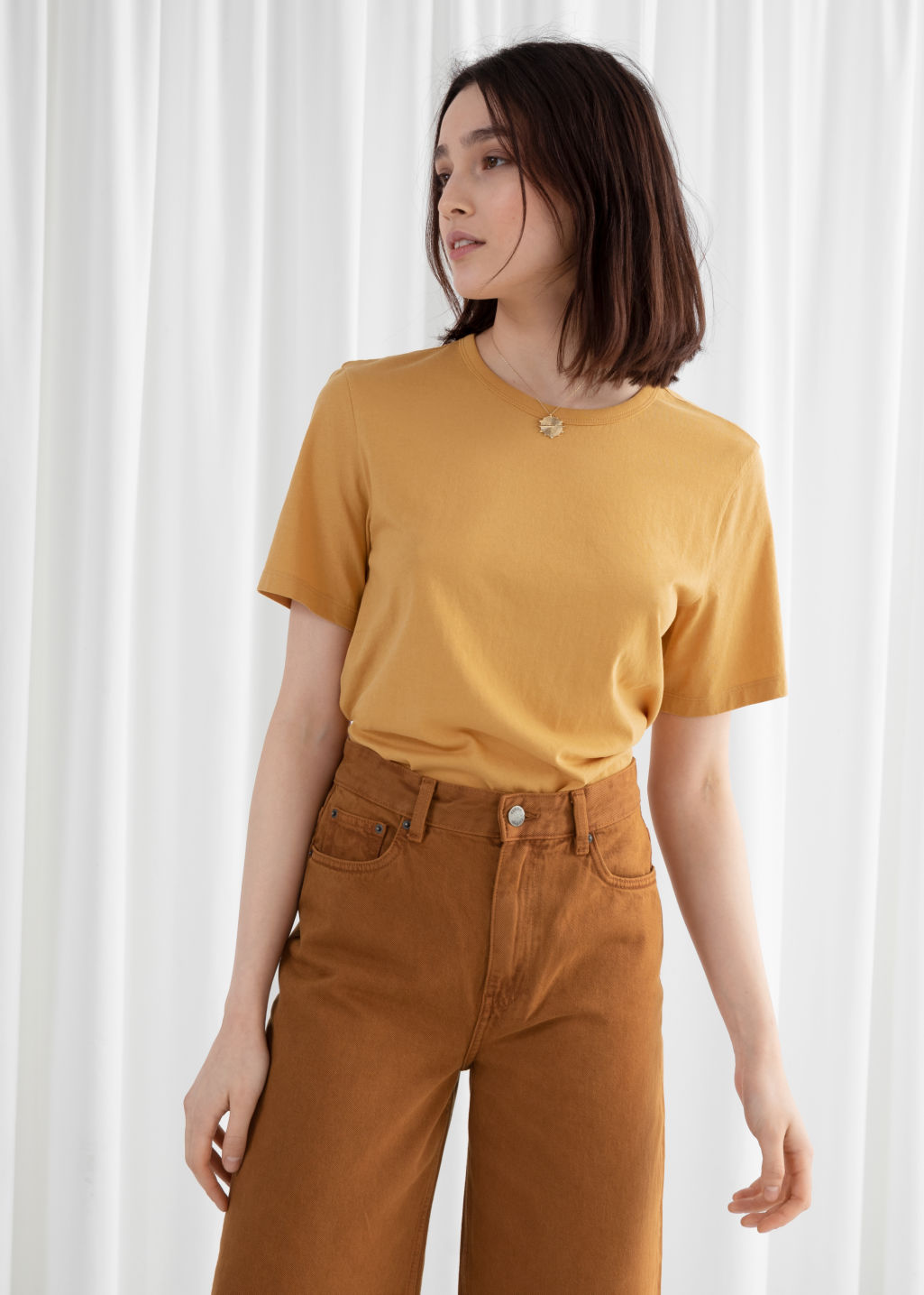 Model front image of Stories organic cotton tee in yellow
