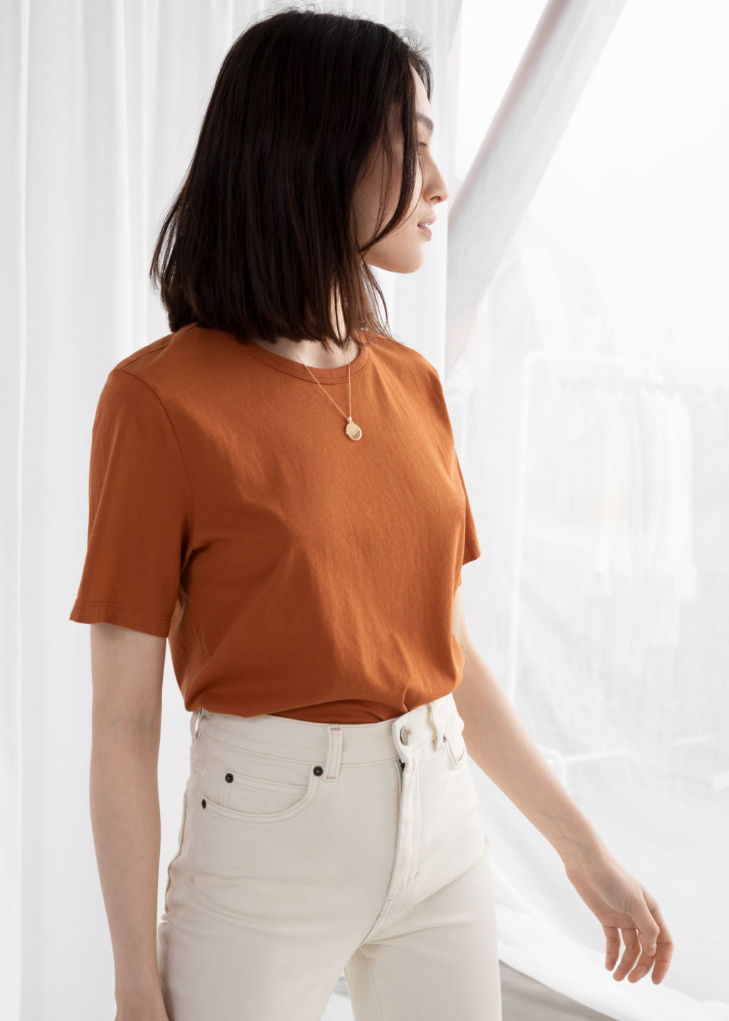 Model front image of Stories organic cotton tee in orange
